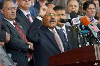 FILE - Former Yemeni President Ali Abdullah Saleh speaks during a ceremony to celebrate the 35th anniversary of the founding of the Popular Conference Party, in Sanaa, Yemen.