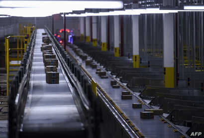 Orders move down a conveyor belt at the 855,000-square-foot Amazon fulfillment center in Staten Island, one of the five boroughs of New York City, Feb. 5, 2019.