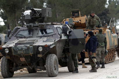 Turkish forces and members of the Free Syrian Army are seen on the outskirts of al-Bab, Feb. 4, 2017.