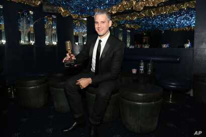 FILE - Paul Epworth, winner of the Best Producer award, is seen at the Music Producers Guild Awards 2013 at the Cafe De Paris in London, Feb. 7, 2013.