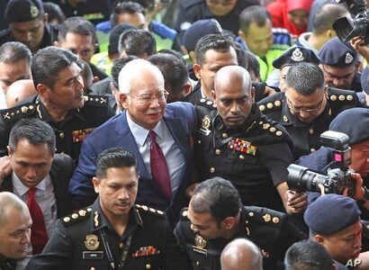 Former Malaysian Prime Minister Najib Razak, center, arrives at a court house in Kuala Lumpur, Malaysia, July 4, 2018.