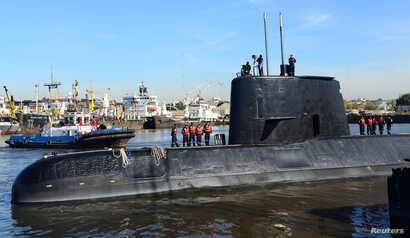 FILE - The Argentine military submarine ARA San Juan and crew are seen leaving the port of Buenos Aires, Argentina, June 2, 2014.