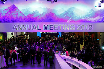Attendees take part at a reception event after the Crystal Award ceremony during the World Economic Forum (WEF) annual meeting in Davos, Switzerland, Jan. 22, 2018.