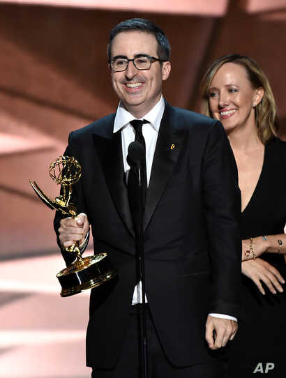 """John Oliver and the crew of """"Last Week Tonight with John Oliver"""" accept the award for outstanding variety talk series at the 68th Primetime Emmy Awards on Sunday, Sept. 18, 2016, in Los Angeles."""