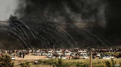 Israeli forces fire tear gas at demonstrators east of Gaza City along the border between the Gaza Strip and Israel during confrontations with Palestinian protesters, June 29, 2018.