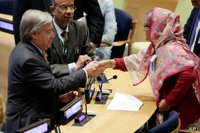 Bangladesh Prime Minister Sheikh Hasina Wazed, right, is greeted by United Nations Secretary General Antonio Guterres, left, in the High-Level meeting on the Prevention of Sexual Exploitation and Abuse, at United Nations headquarters, Sept. 18, 2017....