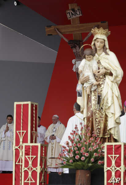 Pope Francis celebrates Mass in Villavicencio, Colombia, Sept. 8, 2017. A statue of Our Lady of Mount Carmel stands in the foreground.
