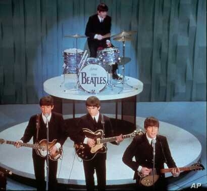"""In this Feb. 9, 1964 picture, The Beatles perform at the """"Ed Sullivan Show,"""" in New York."""