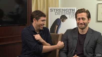 "Actor Jake Gyllenhaal with Boston Marathon bombing survivor Jeff Bauman, whom he plays in the movie ""Stronger"", Sept. 21, 2017. (Photo: P. Poulou / VOA )"