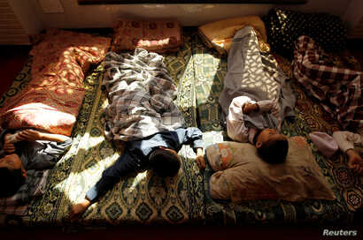 Younger students take an afternoon nap at the Al-Nadwa Madrassa in Murree, Pakistan, Oct. 24, 2017.