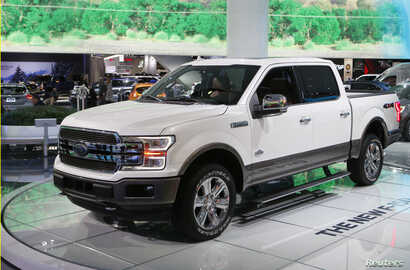 "A 2018 Ford F-150 ""King Ranch"" pickup truck is displayed during the North American International Auto Show in Detroit, Mich.,  Jan. 10, 2017. The F-150 is one of several 2018 Ford models on which automatic braking will be offered."