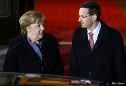 Poland's Prime Minister Mateusz Morawiecki welcomes Germany's Chancellor Angela Merkel at the Chancellery of the Prime Minister in Warsaw, Poland, March 19, 2018.