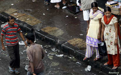 FILE - Two female sex workers stand on a roadside pavement for soliciting customers in a red light area in Mumbai July 28, 2007. An exclusive magazine for prostitutes is offering a snapshot of life in some of India's biggest brothels, reporting the m...