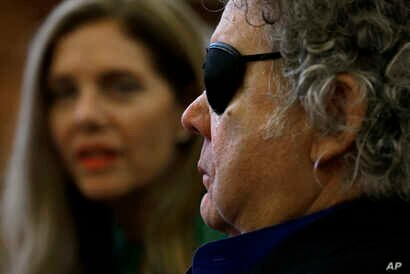 Glass artist Dale Chihuly, right, sheds a tear as he and his wife Leslie, left, talk about his struggle with mental health in his private studio in Seattle, March 22, 2017.
