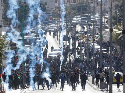Israeli troops fire teargas towards Palestinians during a protest against U.S. President Donald Trump's decision to recognize Jerusalem as the capital of Israel in the West Bank city of Bethlehem, Dec. 7, 2017.