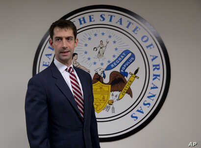 Sen. Tom Cotton, R-Ark. arrives in his office on Capitol Hill in Washington, March 11, 2015.