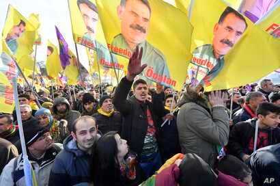 Pro-Kurdish demonstrators protest against Turkish President Recep Tayyip Erdogan and the political repression that followed July's failed military coup,  in Cologne, Germany, Nov. 12, 2016.