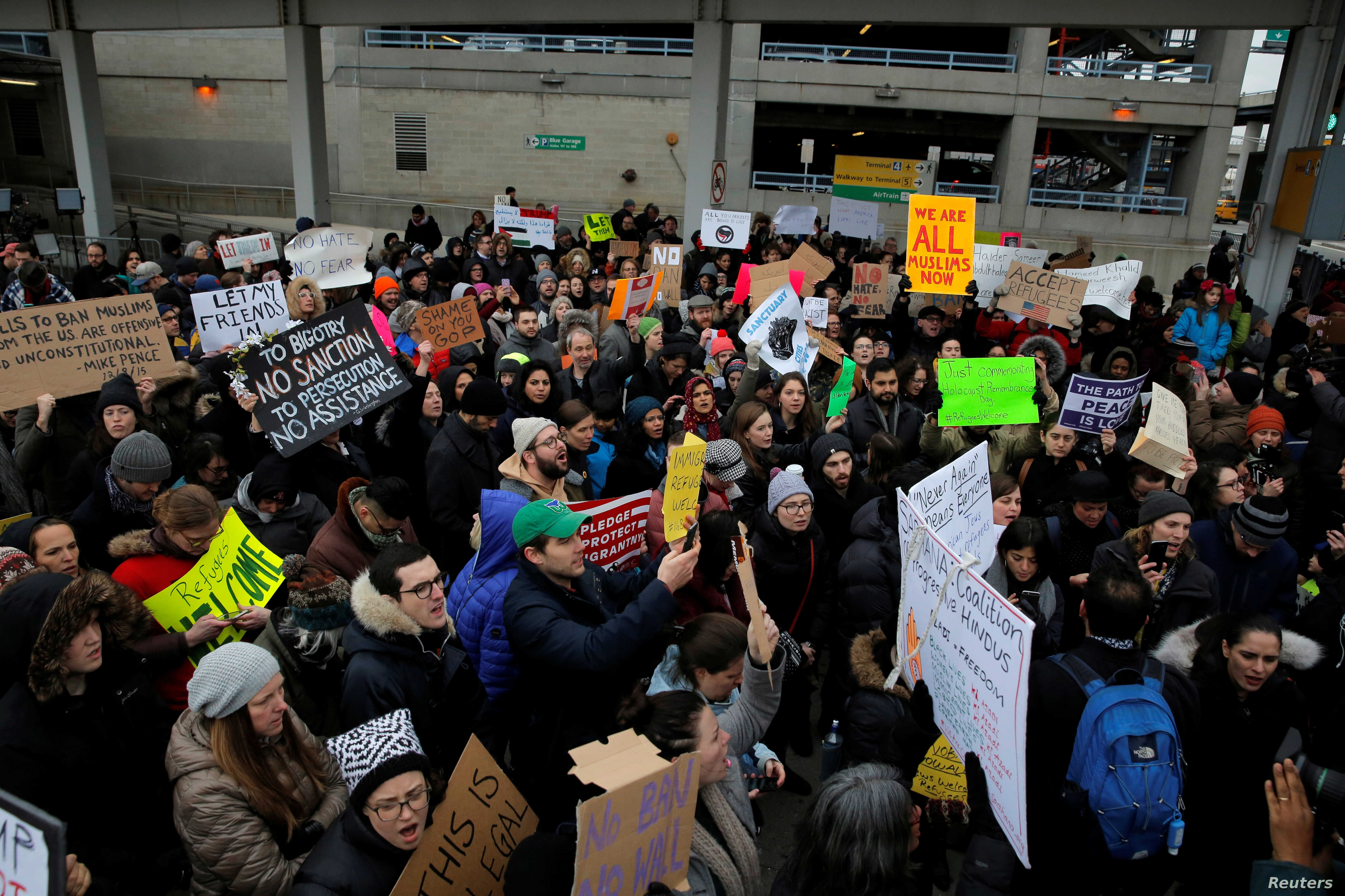 A crowd gathers during an anti-Donald Trump immigration ban protest outside Terminal 4 at John F. Kennedy International Airport in Queens, New York, Jan. 28, 2017.