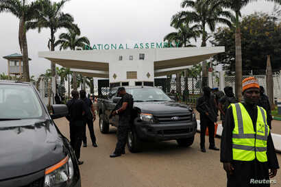 Members of security forces stand at the entrance of the National Assembly in Abuja, Nigeria, Aug. 7, 2018.