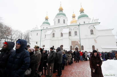 People queue to view the Tomos, a decree with which Ecumenical Orthodox Patriarch Bartholomew granted the Orthodox Church of Ukraine independence, at St. Sophia Cathedral in Kyiv, Ukraine, Jan. 7, 2019.