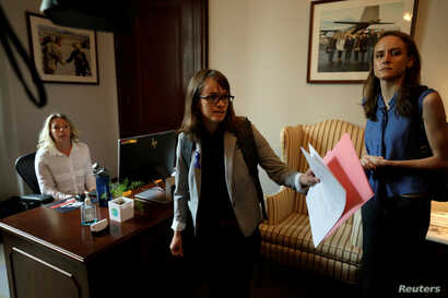 Holton-Arms alumna Alexis Goldstein (C) and Sarah Burgess arrive at office of Senator Shelley Moore Capito (R-WV) to deliver a letter from more than 1,000 fellow Holton-Arms high school graduates supporting fellow graduate Dr. Christine Blasey Ford a...