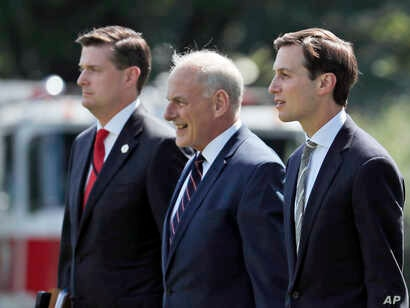 FILE - (L-R) White House Staff Secretary Rob Porter, White House Chief of Staff John Kelly, and White House senior adviser Jared Kushner walk to Marine One on the South Lawn of the White House in Washington,Aug. 4, 2017.