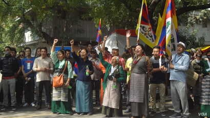 Tibetans and supporters protest in front of the Chinese Embassy in New Delhi to mark the 58th anniversary of China's presence in Tibet, March 10, 2017. (T. Wangyal/VOA)