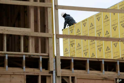 FILE- Work continues on a new development in Fair Lawn, N.J., Feb. 26, 2018. On Friday, the Labor Department will release its report on how many jobs U.S. employers added in March.