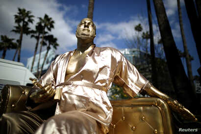 A statue of Harvey Weinstein on a casting couch made by artist Plastic Jesus is seen on Hollywood Boulevard near the Dolby Theatre during preparations for the Oscars in Hollywood, Los Angeles, California, U.S. March 1, 2018.