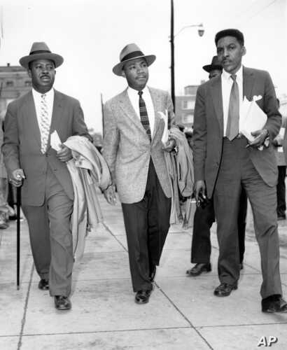 FILE - The Rev. Ralph Abernathy (L), Rev. Dr. Martin Luther King, Jr. (C), and Bayard Rustin, leaders in the racial bus boycott in Montgomery, Ala., leave the Montgomery County Courthouse on Feb. 24, 1956.
