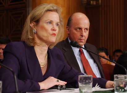FILE - In this April 7, 2004 file photo, Robin Raphel, coordinator of the State Department's Office of Iraq Reconstruction,  discusses the U. N.'s Oil for Food Program on Capitol Hill  during an appearance before Senate Foreign Relations Committee.