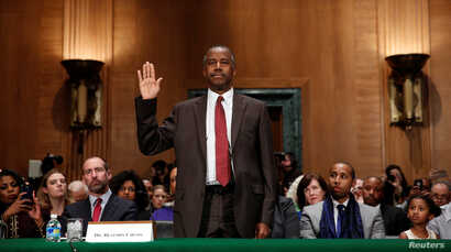Dr. Ben Carson is sworn in to testify before a Senate Banking, Housing and Urban Affairs Committee confirmation hearing on his nomination to be Secretary of the U.S. Department of Housing and Urban Development on Capitol Hill in Washington, Jan. 12, ...