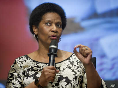 FILE - Phumzile Mlambo-Ngcuka, executive director, UN Women,  addresses the World Bank Group's report on pervasive constraints facing women and girls worldwide, World Bank headquarters, Washington, May 14, 2014.