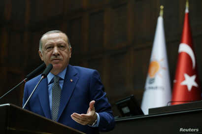 Turkish President Tayyip Erdogan addresses members of parliament from his ruling AK Party (AKP) during a meeting at the Turkish parliament in Ankara, Oct. 30, 2018. (Presidential Press Office/Handout via Reuters)