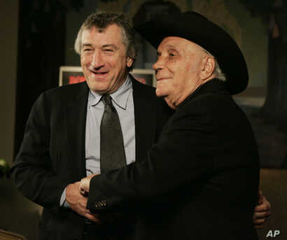 "Boxer Jake LaMotta, right, and actor Robert DeNiro stand for photographers before watching a 25th anniversary screening of the movie ""Raging Bull"" in New York, Jan. 27, 2005."
