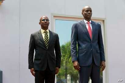 Haiti's President Jovenel Moise stands with the newly-named interim Prime Minister Jean Michel Lapin, during the national anthem at the minister's presentation ceremony in Port-au-Prince, Haiti, March 21, 2019