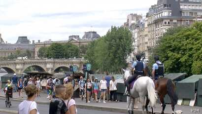 Bouquinistes line the left bank of the Seine River in Paris.