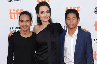 """Maddox Jolie-Pitt, from left, Angelina Jolie and Pax Jolie-Pitt attend a premiere for """"First They Killed My Father"""" on day 5 of the Toronto International Film Festival at the Princess of Wales Theatre, Sept. 11, 2017, in Toronto."""