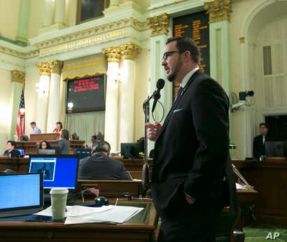 """Assemblyman Devon Mathis, R-Visalia, urges lawmakers to reject a """"sanctuary state"""" bill before the Assembly Sept. 15, 2017, in Sacramento, Calif."""