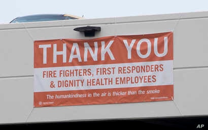 In this photo taken  Aug. 2, 2018, a thank-you banner for firefighters, first responders and hospital workers hangs outside Mercy Medical Center in Redding, Calif. Dozens of staff members, including doctors, nurses and others at the medical center, a...