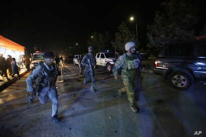 Afghan security forces rush to respond to a complex Taliban attack on the campus of the American University in Kabul, Aug. 24, 2016.