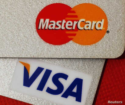 FILE - MasterCard and VISA credit cards are seen in this illustrative photograph taken in Hong Kong, Dec. 8, 2010.