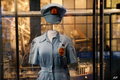 """A female ordinance plant worker's uniform is part of the permanent exhibit """"Salute to the Home Front."""" The exhibit tells the home front story from the 1920s to the development of the atomic bomb."""