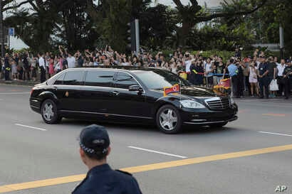 The limousine of Kim Jong Un arrives at the Istana, or Presidential Palace, in Singapore on June 10, 2018, to meet Singapore Prime Minister Lee Hsien Loong ahead the summit between U.S. leader Donald Trump and North Korea leader Kim.
