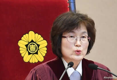 South Korean acting Constitutional Court's Chief Judge Lee Jung-mi during final ruling of President Park Geun-hye's impeachment at the Constitutional Court in Seoul, South Korea, March 10, 2017.