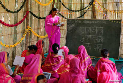 Sheetal Prakash More (R), a 30-year-old teacher, teaches at Aajibaichi Shaala (Grandmothers' School) in Fangane village, India, Feb. 15, 2017.