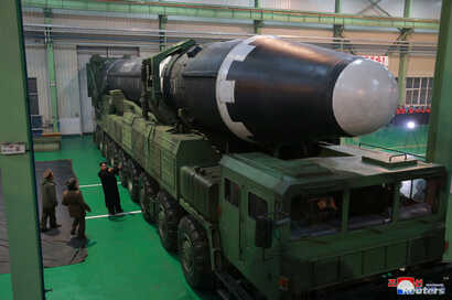 North Korea's leader Kim Jong Un is seen as the newly developed intercontinental ballistic rocket Hwasong-15's test was successfully launched, in this undated photo released by North Korea's Korean Central News Agency in Pyongyang, Nov. 30, 2017.