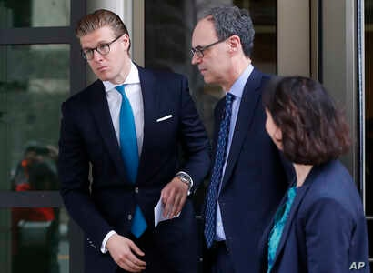 Alex van der Zwaan, left, leaves Federal District Court in Washington, April 3, 2018. A federal judge sentenced Alex van der Zwaan to 30 days in prison.