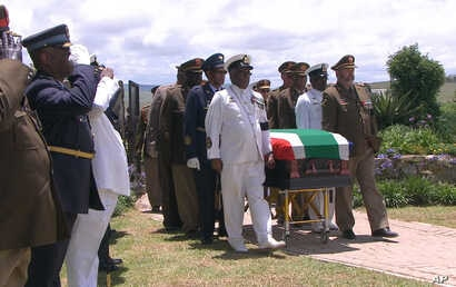 In this video frame grab, military officers escort former South African President Nelson Mandela's casket as it arrives at his burial site following his funeral service in Qunu, South Africa, Dec. 15, 2013.