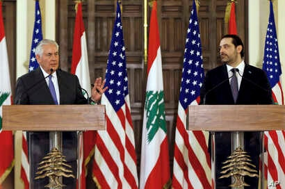 U.S. Secretary of State Rex Tillerson, left, speaks during a press conference with Lebanese Prime Minister Saad Hariri, at the Government House, in downtown Beirut, Lebanon, Thursday, Feb. 15, 2018.